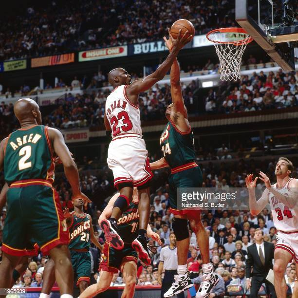 Michael Jordan of the Chicago Bulls drives to the basket against the Seattle SuperSonics during Game one of the 1996 NBA Finals at the United Center...