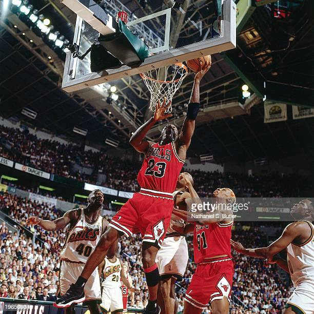 Michael Jordan of the Chicago Bulls drives to the basket against the Seattle SuperSonics during Game five of the 1996 NBA Finals at the KeyArena on...
