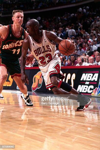Michael Jordan of the Chicago Bulls drives to the basket against the Seattle Sonics during Game One of the 1996 NBA Finals at United Center on June 5...