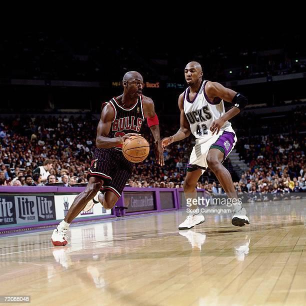 Michael Jordan of the Chicago Bulls drives to the basket against Vin Baker of the Milwaukee Bucks at the Bradley Center on June 10 1997 in Milwaukee...