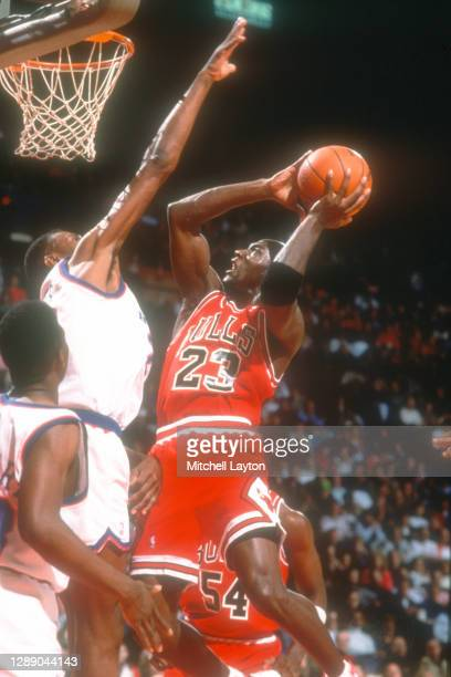Michael Jordan of the Chicago Bulls drives to the basket during a NBA basketball game against the Washington Bullets at USAir Arena on April 3, 1997...