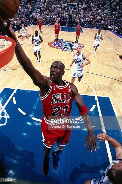 Michael Jordan of the Chicago Bulls drives to the basket for a layup against the Utah Jazz during game 6 of the NBA Finals in Salt Lake City Utah...