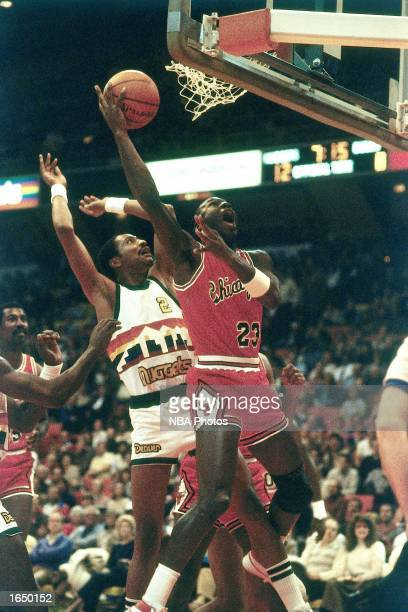 Michael Jordan of the Chicago Bulls drives to the basket for a layup during the 1980 NBA game against the Denver Nuggets in Denver Colorado NOTE TO...
