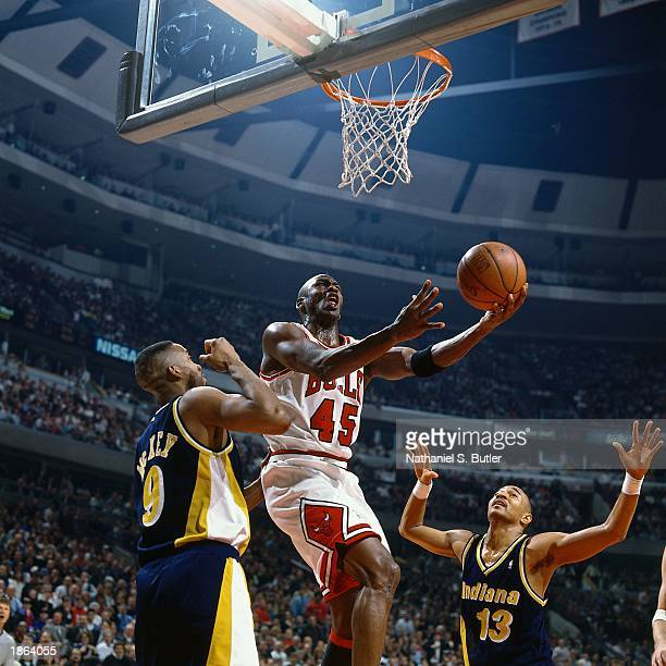 Michael Jordan of the Chicago Bulls drives to the basket for a layup against the Indiana Pacers during the 1995 season NBA game in Chicago Illinois...