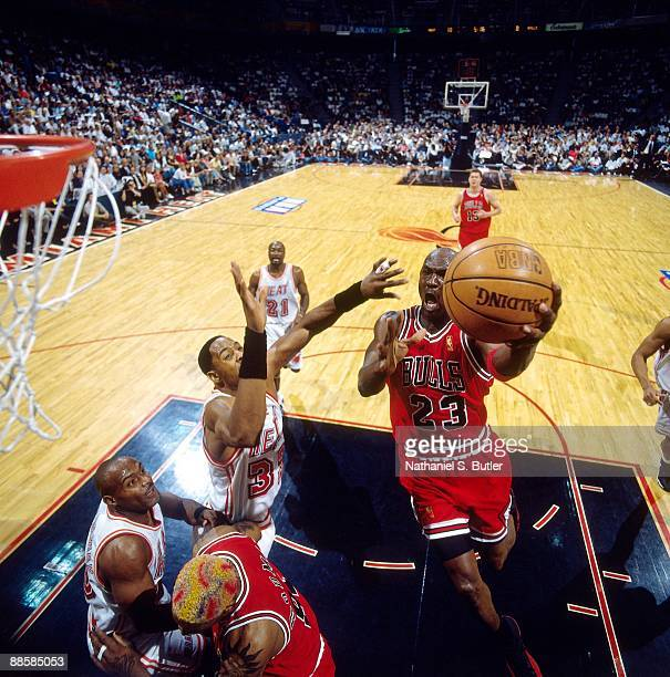 Michael Jordan of the Chicago Bulls drives to the basket for a layup against Alonzo Mourning of the Miami Heat in Game Four of the Eastern Conference...