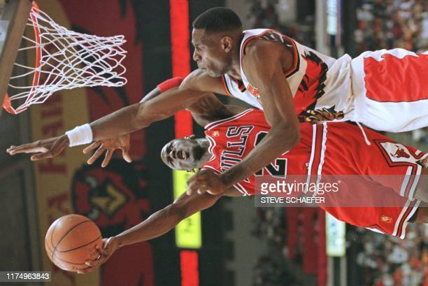 Michael Jordan of the Chicago Bulls drives to the basket past Dikembe Mutombo of the Atlanta Hawks 10 May during the first half of game three of...