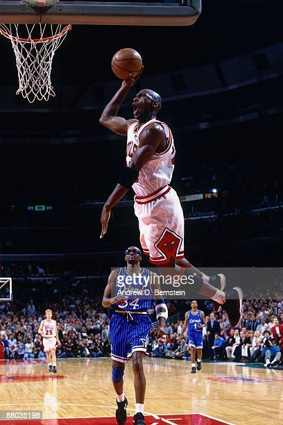 Michael Jordan of the Chicago Bulls dunks against Horace Grant of the Orlando Magic in Game Six of the Eastern Conference Semifinals during the 1995...