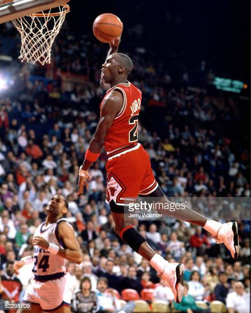 Michael jordan of the Chicago Bulls dunks against Jeff Malone of the Washington Bullets circa 1990 at the Capital Center in Washington, D.C. NOTE TO...