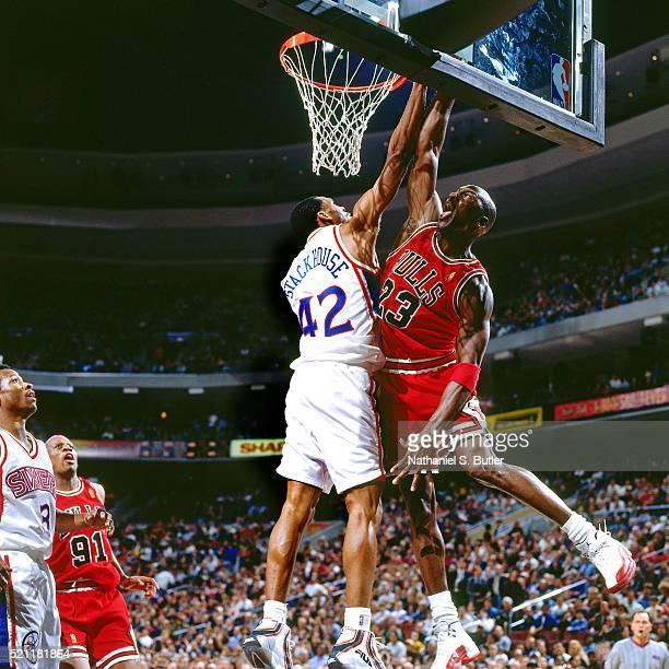 Michael Jordan of the Chicago Bulls dunks against Jerry Steakhouse of the Philadelphia 76ers at CoreStates Center on March 12 1997 in Philadelphia...