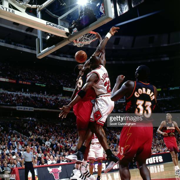 Michael Jordan of the Chicago Bulls dunks against the Atlanta Hawks during Game Five round two of the 1997 NBA Playoffs at the United Center in...