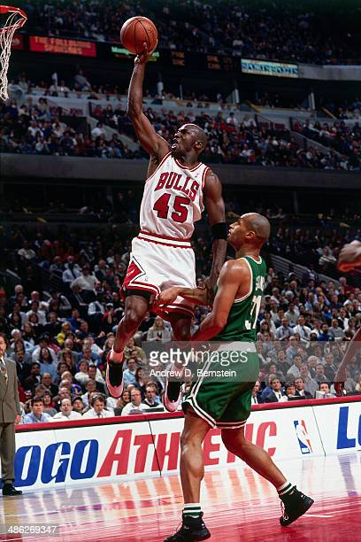 Michael Jordan of the Chicago Bulls dunks against the Boston Celtics circa 1995 at the United Stadium in Chicago Illinois NOTE TO USER User expressly...