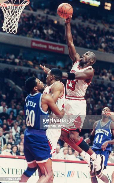 Michael Jordan of the Chicago Bulls dunks against the Charlotte Hornets at the United Center on April 08, 1996 in Chicago, Illinois.
