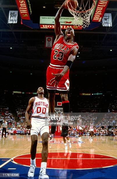 Michael Jordan of the Chicago Bulls dunks against the Detroit Pistons circa 1990 at The Palace of Auburn Hills in Auburn Hills Michigan NOTE TO USER...