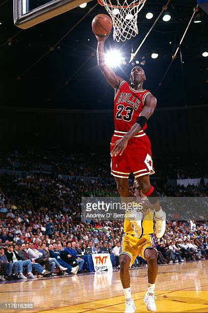 Michael Jordan of the Chicago Bulls dunks against the Los Angeles Lakers circa 1993 at The Staples Center in Los Angeles California NOTE TO USER User...