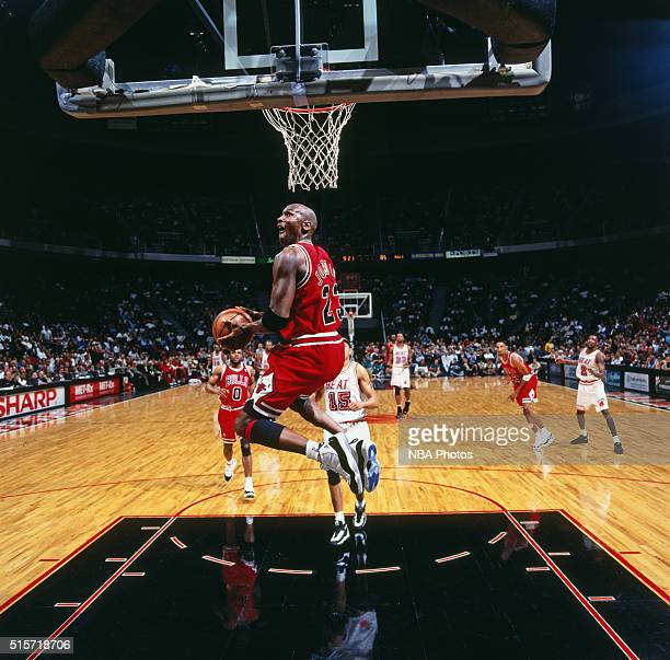 Michael Jordan of the Chicago Bulls dunks against the Miami Heat on April 2 1996 at Miami Arena in Miami Florida NOTE TO USER User expressly...