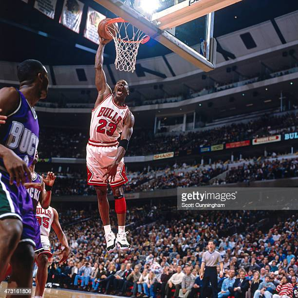 Michael Jordan of the Chicago Bulls dunks against the Milwaukee Bucks circa 1996 in Chicago IL NOTE TO USER User expressly acknowledges and agrees...