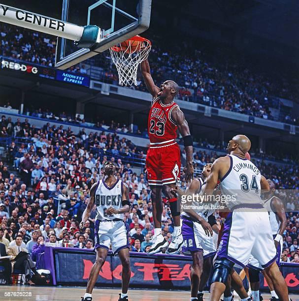 Michael Jordan of the Chicago Bulls dunks against the Milwaukee Bucks on April 16 1996 at the Bradley Center in Milwaukee Wisconsin NOTE TO USER User...