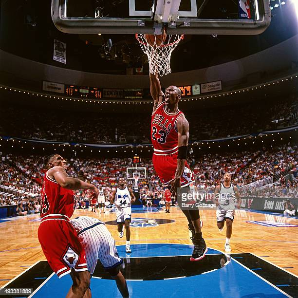 Michael Jordan of the Chicago Bulls dunks against the Orlando Magic during Game Four of the Eastern Conference Semifinals on May 27 1996 at Orlando...