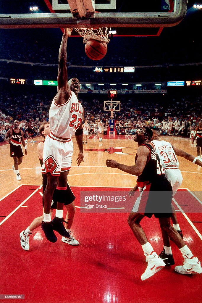 9041006f64f Michael Jordan of the Chicago Bulls dunks against the Portland Trail ...