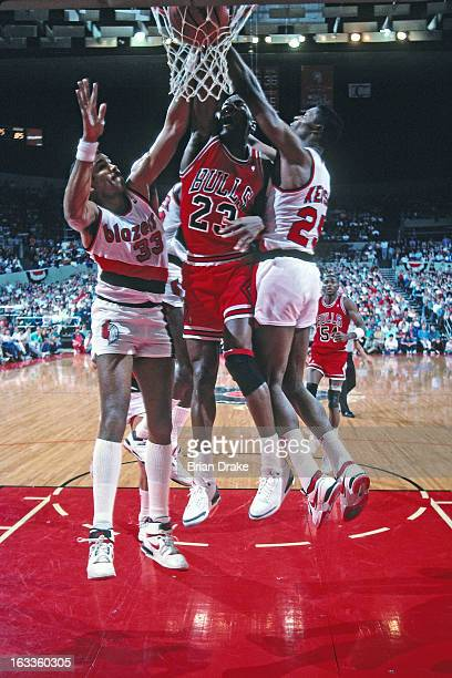 Michael Jordan of the Chicago Bulls dunks against the Portland Trail Blazers during a game played circa 1988 at the Veterans Memorial Coliseum in...