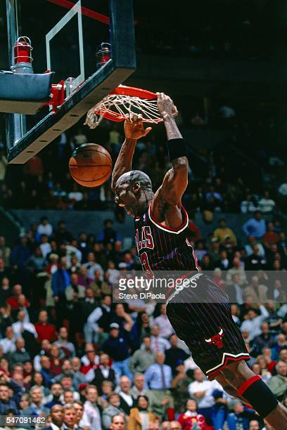 Michael Jordan of the Chicago Bulls dunks against the Portland Trail Blazers circa 1995 at the Veterans Memorial Coliseum in Portland Oregon NOTE TO...