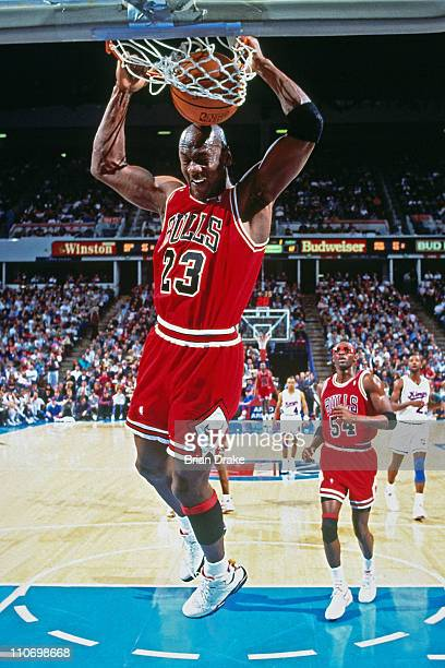 Michael Jordan of the Chicago Bulls dunks against the Sacramento Kings during a game played at the Arco Arena in Sacramento California circa 1993...