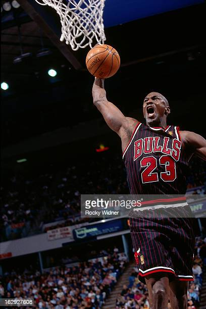 Michael Jordan of the Chicago Bulls dunks against the Sacramento Kings during a game played on January 30 1997 at Arco Arena in Sacramento California...