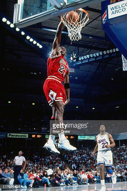 Michael Jordan of the Chicago Bulls dunks against the Sacramento Kings at Arco Arena in Sacramento California circa 1993 NOTE TO USER User expressly...