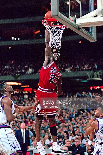 Michael Jordan of the Chicago Bulls dunks against the Toronto Raptors on January 18 1996 at SkyDome in Toronto Canada NOTE TO USER User expressly...