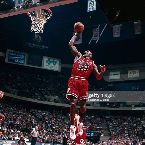 Michael Jordan of the Chicago Bulls dunks circa 1998 at The Izod Center in Rutherford New Jersey NOTE TO USER User expressly acknowledges and agrees...