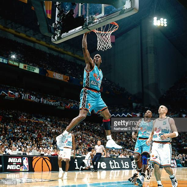 Michael Jordan of the Chicago Bulls dunks the ball against the Western Conference AllStar Team at the 1996 NBA AllStar Game on February 10 1996 at...