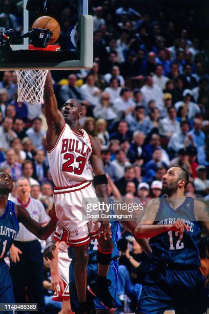 Michael Jordan of the Chicago Bulls dunks the ball against the Charlotte Hornets on May 6, 1998 at the United Center in Chicago, Illinois. NOTE TO...