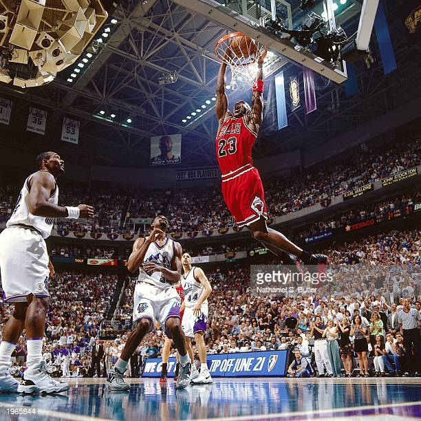 Michael Jordan of the Chicago Bulls dunks the ball against the Utah Jazz during Game three of the 1997 NBA Finals at the Delta Center on June 6, 1997...