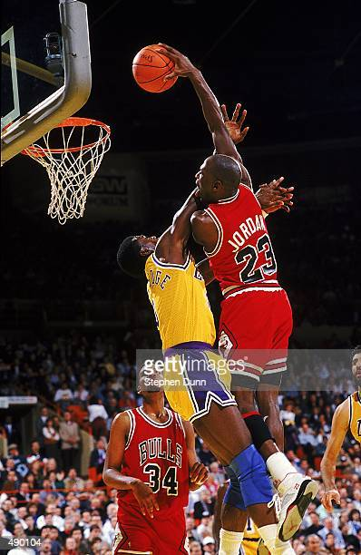 Michael Jordan of the Chicago Bulls dunks the ball during a game against the Los Angeles Lakers
