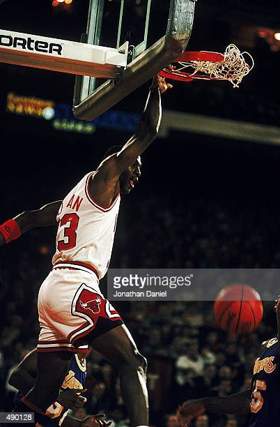 Michael Jordan of the Chicago Bulls dunks the ball during a game against the Los Angeles Lakers at the United Center in Chicago Illinois