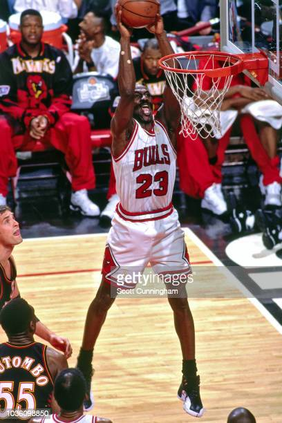 Michael Jordan of the Chicago Bulls dunks the ball during the game against the Atlanta Hawks on May 8 1997 at the United Center in Chicago IL NOTE TO...