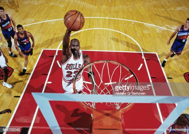 Michael Jordan of the Chicago Bulls dunks the ball during the game against the Phoenix Suns on March 30 1993 at Chicago Stadium in Chicago Illinois...