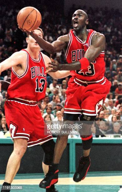 Michael Jordan of the Chicago Bulls flies to the basket past Luc Longley 10 May in game four of their Eastern Conference semifinal against the...