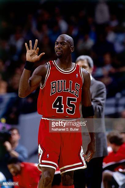 Michael Jordan of the Chicago Bulls gestures in Game One of the Eastern Conference Quarterfinals during the 1995 NBA Playoffs at the Charlotte...