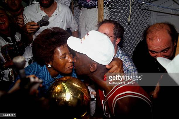 Michael Jordan of the Chicago Bulls gets congratulated by his mother after winning the 1991 NBA Championship against the Los Angeles Lakers in Los...