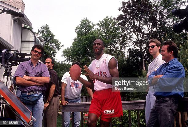 Michael Jordan of the Chicago Bulls gets ready to throw a football during a photo shoot in May 1992