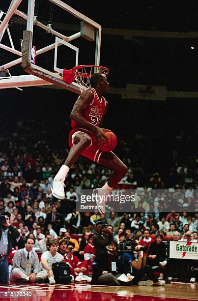 Michael Jordan of the Chicago Bulls gets set to dunk the ball during the slam dunk contest 2/8 Jordan won the contest