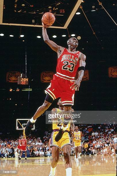 Michael Jordan of the Chicago Bulls goes for a dunk against the Los Angeles Lakers in game five of the 1991 NBA Finals on June 12, 1991 at the Great...