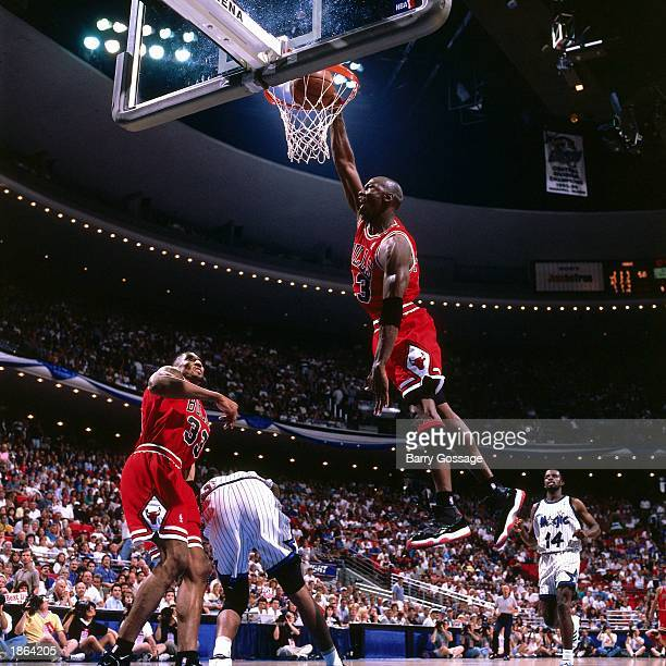 Michael Jordan of the Chicago Bulls goes for a dunk against the Orlando Magic during Game Four of the 1996 NBA Playoff Semifinals at Orlando Arena in...