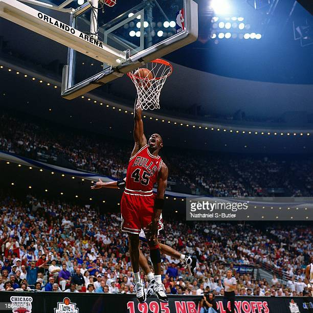 Michael Jordan of the Chicago Bulls goes for a dunk against the Orlando Magic during Game One round two of the 1995 NBA Playoffs at Orlando Arena in...