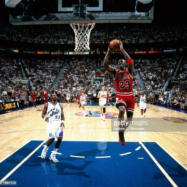 Michael Jordan of the Chicago Bulls goes for a dunk against the Utah Jazz during Game Four of the 1997 NBA Championship Finals in Salt Lake City Utah...