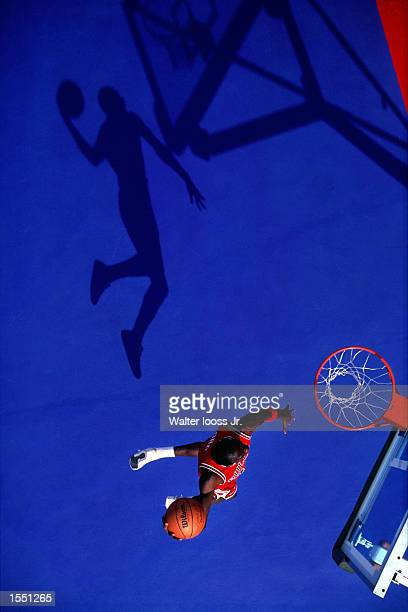 Michael Jordan of the Chicago Bulls goes for a dunk during a photo shoot in Chicago Illinois NOTE TO USER User expressly acknowledges and agrees that...