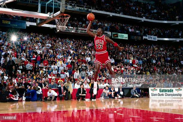 Michael Jordan of the Chicago Bulls goes for a dunk during the 1988 NBA All Star Slam Dunk Competition on February 6, 1988 at Chicago Stadium in...