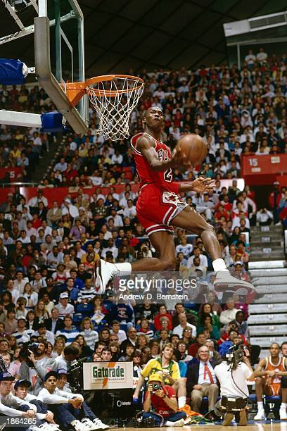 Michael Jordan of the Chicago Bulls goes for a dunk during the Slam Dunk Competition, part of the 1987 NBA All-Star Weekend at the Kingdome in...