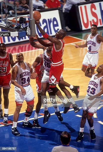Michael Jordan of the Chicago Bulls goes for the layup duing a game in the 1991 Eastern Conference Semifinals against the Philadelphia 76ers in May...
